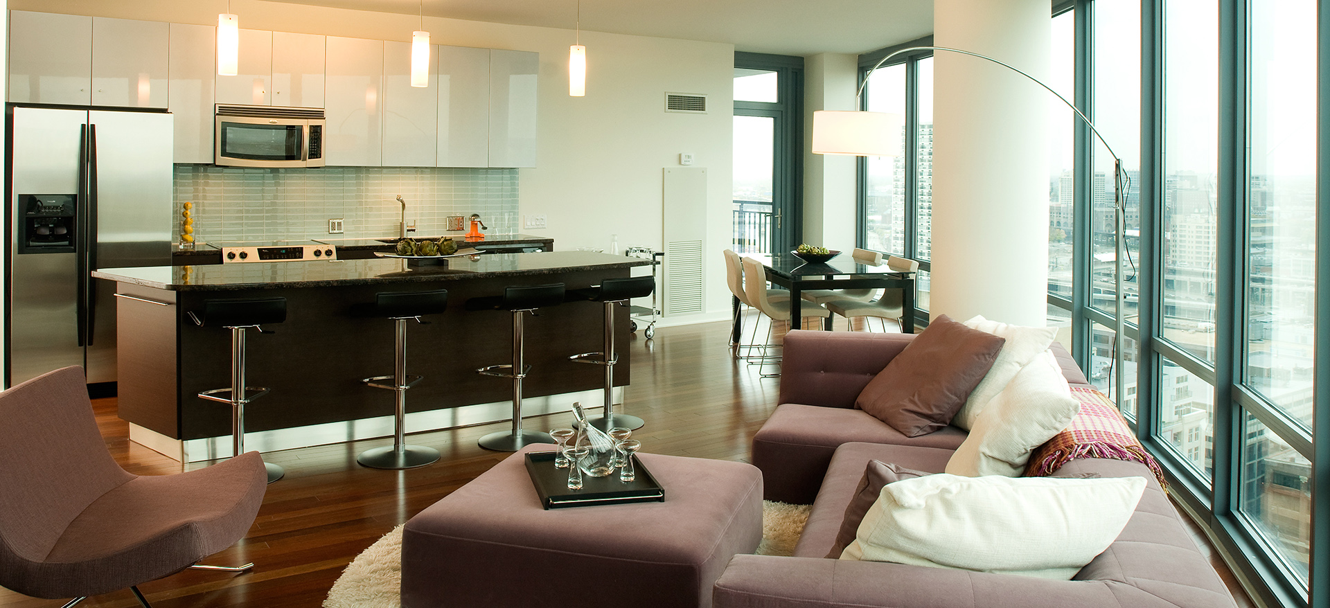 Apartment living room and kitchen with island breakfast bar